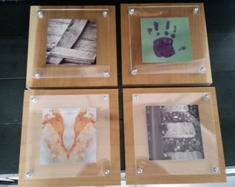 Four floating picture frames