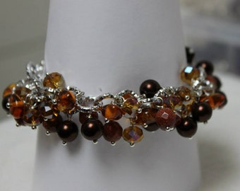 Gemstone and Crystal bracelet amber pendants.