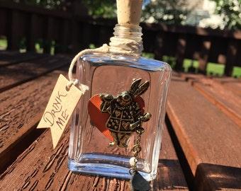 """Wonderland """"Drink Me"""" glass bottle."""