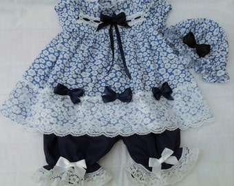 Blue and white outfit with navy blue bloomers and mop cap