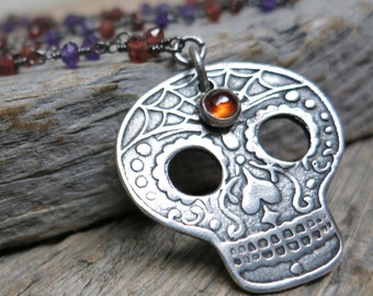 E&A Sugar Skull 2016 necklace ... recycled fine silver / original sugar skull design / hessonite garnet / amethyst