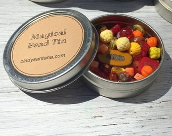 Glass beads, tin of beads,  bead lot, glass beads and more in a magical bead tin, orange and yellow beads, 2.5 inch aluminum tin 2 ounces