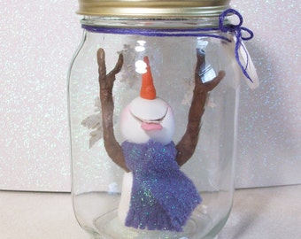 Snowman catching snowflakes in a jar: Flakey Preserves