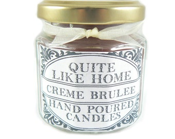 Creme Brulee scented 4 oz. jar candle with gold lid, and organza ribbon. Dessert, caramel, sweet, sugar, sugary, rich, spices, vanilla