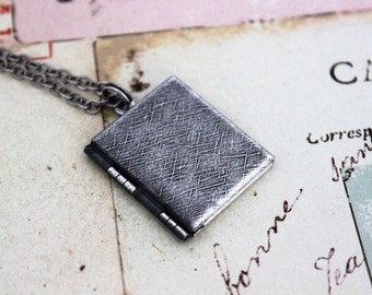 book locket necklace. silver ox jewelry with etched lines