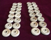 32  Wheels  1-1/4 inch diameter with 1/4 hole  Unfinished Hardwood