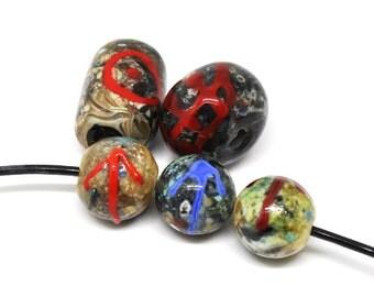 Set of viking beads, runes and helleristning motive