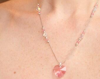 Ensemble rose pâle et transparent incluant collier, bracelet et boucles d'oreilles en cristal Swarovski et argent sterling 925