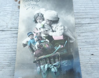 Vintage Antique old French 1900 postcard /  children  with Victorian toys /doll/puppets/ greetings / Bonne année