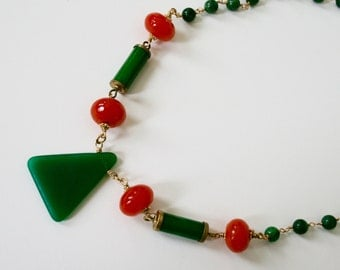 Green triangle with orange necklace