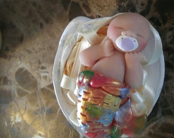 Rainbow baby in a shell