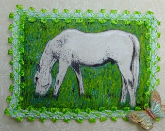 Tiny Art Quilt ATC Pretty White Stallion grazing in a meadow with a butterfly in the corner