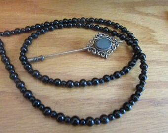 Black onyx beaded necklace with pin