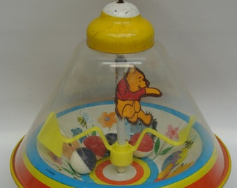Adorable vintage Winnie the Pooh toy top - charming illustrations