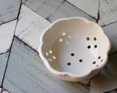 pottery colander in white porcelain