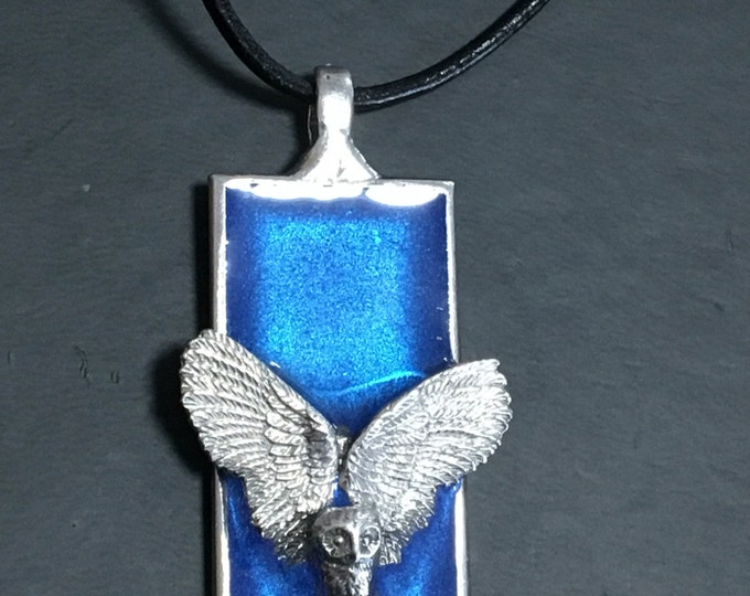 Owl in flight pendant with blue background on leather necklace. Handmade in Australia. Pewter and Resin