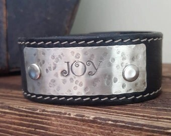 """Black Leather Cuff  with the words """"JOY"""" on hammered Silver Metal-Quote"""