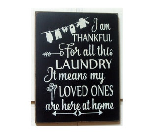 I am thankful for all this laundry it means my loved ones are here at home wood sign