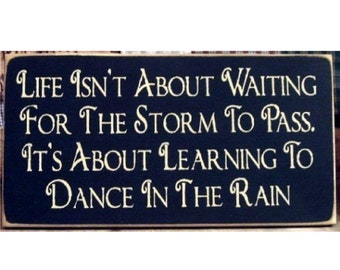 Life is not about waiting for the storm to pass ... primitive wood sign