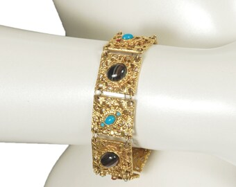 60s vintage Coro Byzantine cabochon bracelet, gold square filigree links, turquoise, onyx + ruby colored stones, flip latch clasp, signed