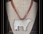 """Charolais X  Show Steer Hair On Hide show steer 3"""" wide leather pendant with cord"""