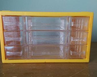 Vintage Plastic 9 Drawer Desktop Storage Organizer.  Yellow Frame with See Through Drawers.