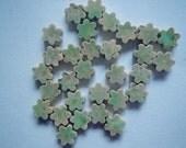 Tiny green flower tiles