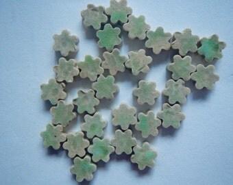 Tiny green flower tiles-.40 each