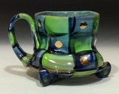 Lime green and blue checkered mug with gold dots