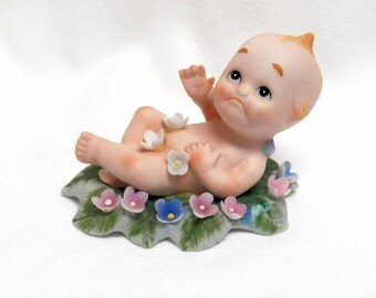 Kewpie Bisque Lefton China on a Bed of Flowers