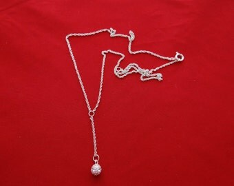 "Vintage silver tone 19"" necklace with  rhinestone ball  in unworn condition, 1.5"" drape"