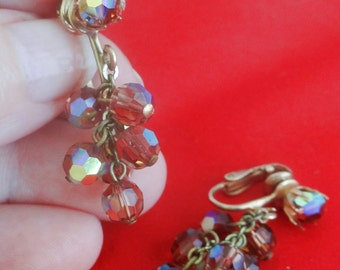 """Vintage 1.25"""" gold tone clip earrings with lavender glass beads in great condition"""