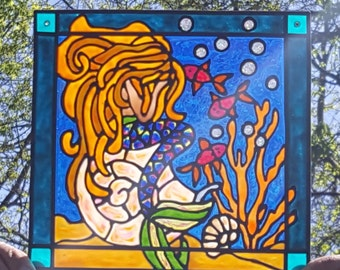Weeping Mermaid with fish on a sea shell stained acrylic glass window