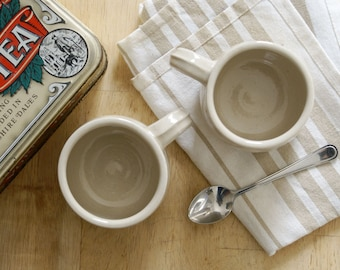 Two stoneware pottery mini mugs - glazed in simply clay