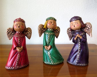 Vintage Holiday Decor 3 singing angel figurines with felt bottoms and neat designs 1970's