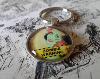 25mm round zombie pinup keychain