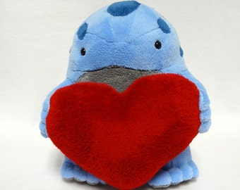 Blue and grey quaggan with red heart