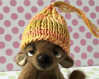 Hand knitted miniature hat
