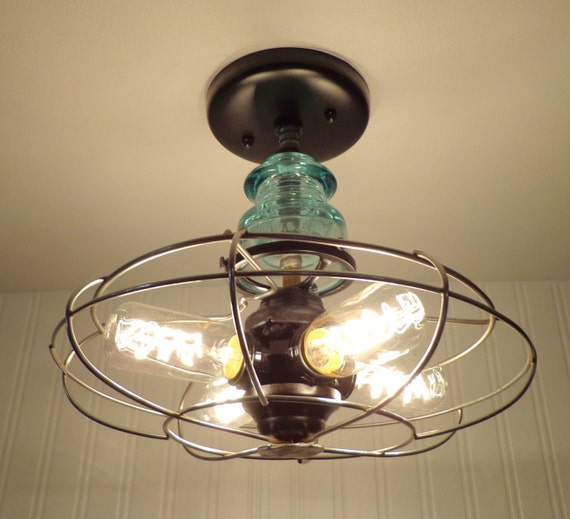 General electric industrial light vintage upcycle by for Repurpose ceiling fan motor