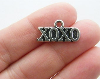 4 XOXO hugs and kisses charms antique silver tone M588