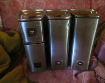 Mid Century Modern  Chrome Canister Set of 4 Inspired Wedge and Stacking Lincoln Beauty Ware with Teak Handles  Flour-Sugar-Coffee-Tea