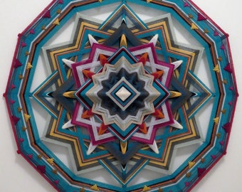 Breaking Free, an all wool, 12-sided, 24 inch Ojo de Dios, handcrafted by Sami Herbert