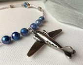 Silver Airplane Necklace with soft Blue Pearls