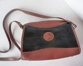 Vintage Dooney and Bourke Black and Saddle Tan Bag All Weather Zip Shoulder Crossbody