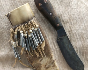 Primitive Nessmuk Mountain Man knife in decorated Rawhide Sheath