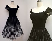 RESERVED Vintage 50s Dress Black and White Dress Ellipse to Circles Bows and Keyhole Back