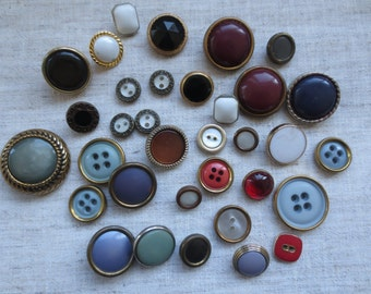 Vintage assorted colors and shapes metal edge plastic shank and sew hole buttons. Lot of 34.