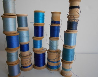 Blue 23 vintage wood spools of cotton/nylon thread. Star/Belding/Nymo/Coats and Clarks