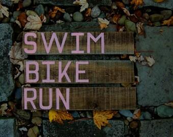 Triathlon Signs in Reclaimed Pallet Wood - SWIM BIKE RUN - Triathlete Gift - 3 Sign Set - Ironman Finisher Signs - Salmon Pink Lettering