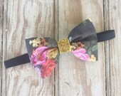 Black floral bow